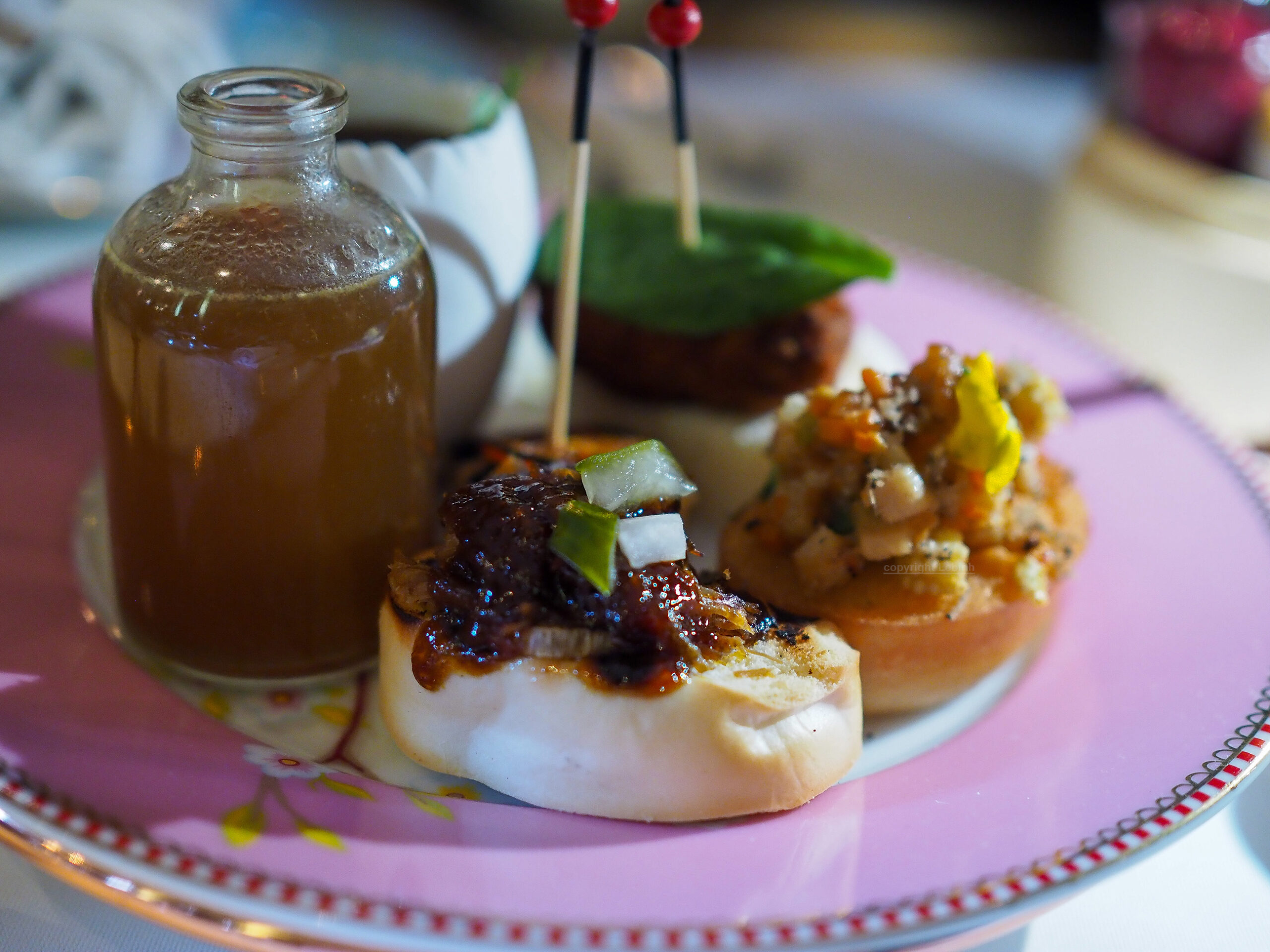 Chai' Bao Sliders, bao with crispy duck, bao chopped vegetables, prawns on toast, Chinese tea egg, and finally the potion of 'eternal youth'